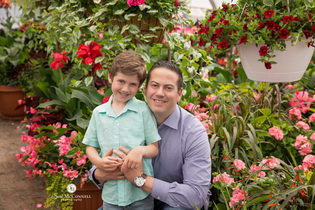 dad with son in front of blooming flowers