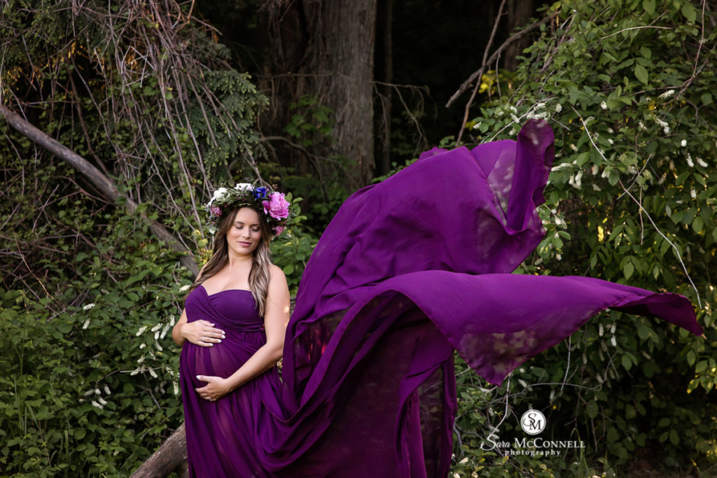 pregnant woman in a purple gown