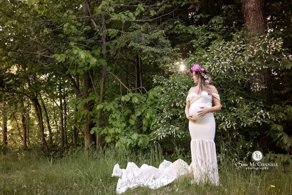 pregnant woman in a white gown