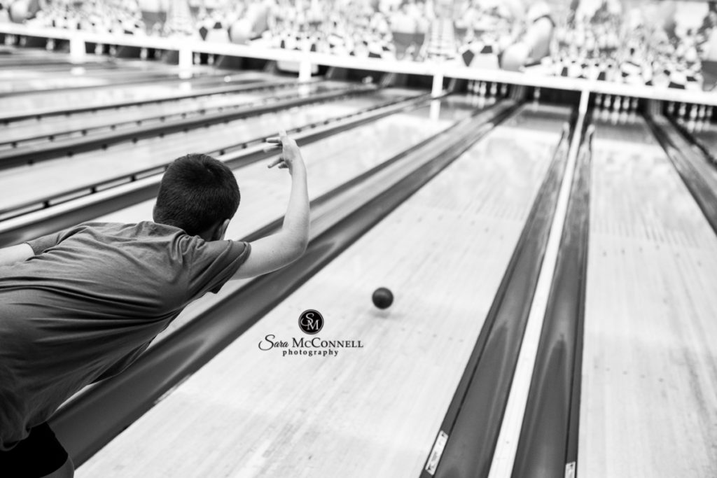 teen boy bowling