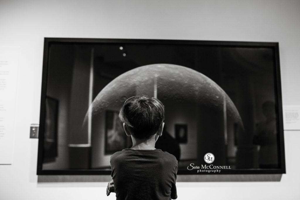 young boy looking at moon image