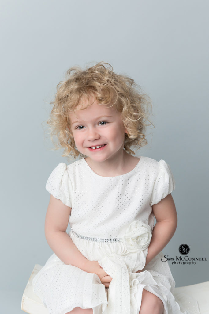 3 year old little girl in a white dress