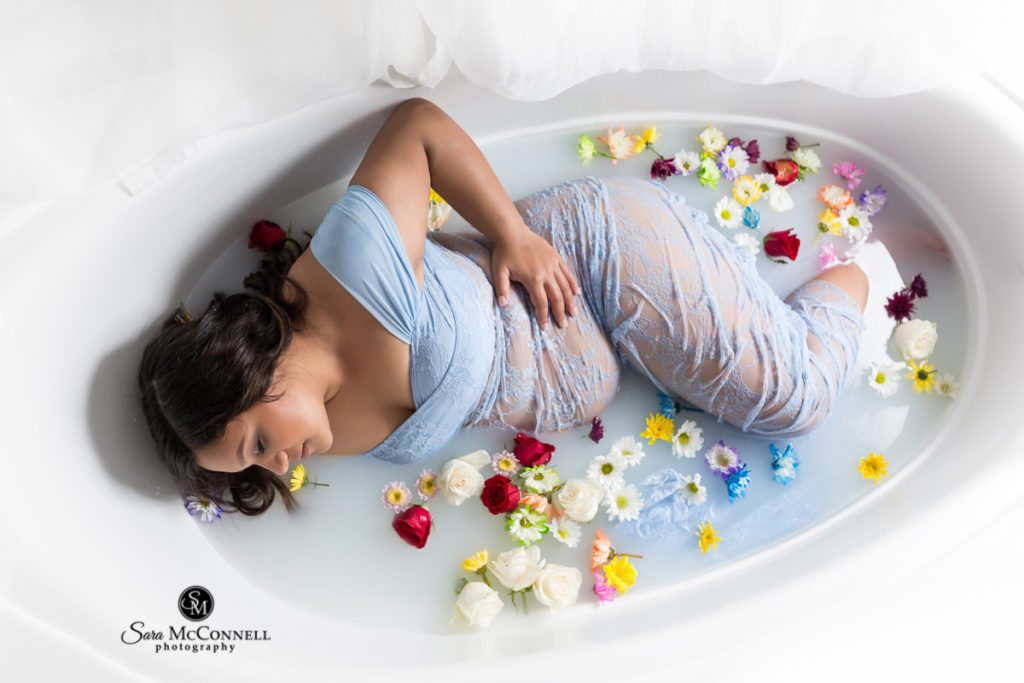 pregnant woman in milk bath flowers