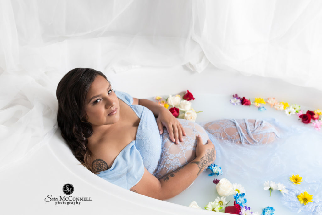 pregnant woman in milk bath with flowers
