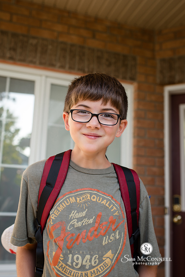 boy wearing backpack for first day of school