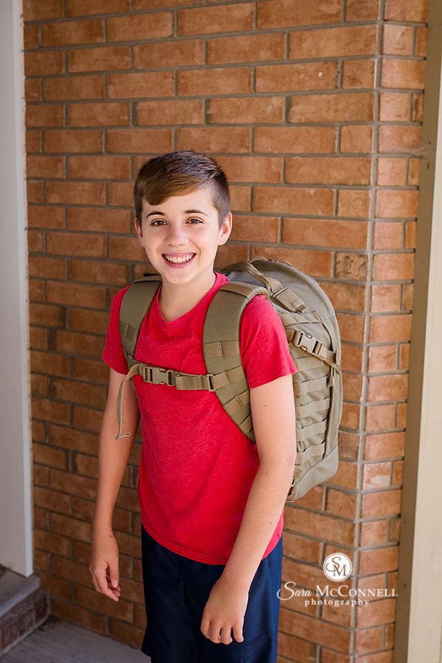 boy wearing backpack on first day of school