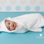 baby wrapped in a bath towel