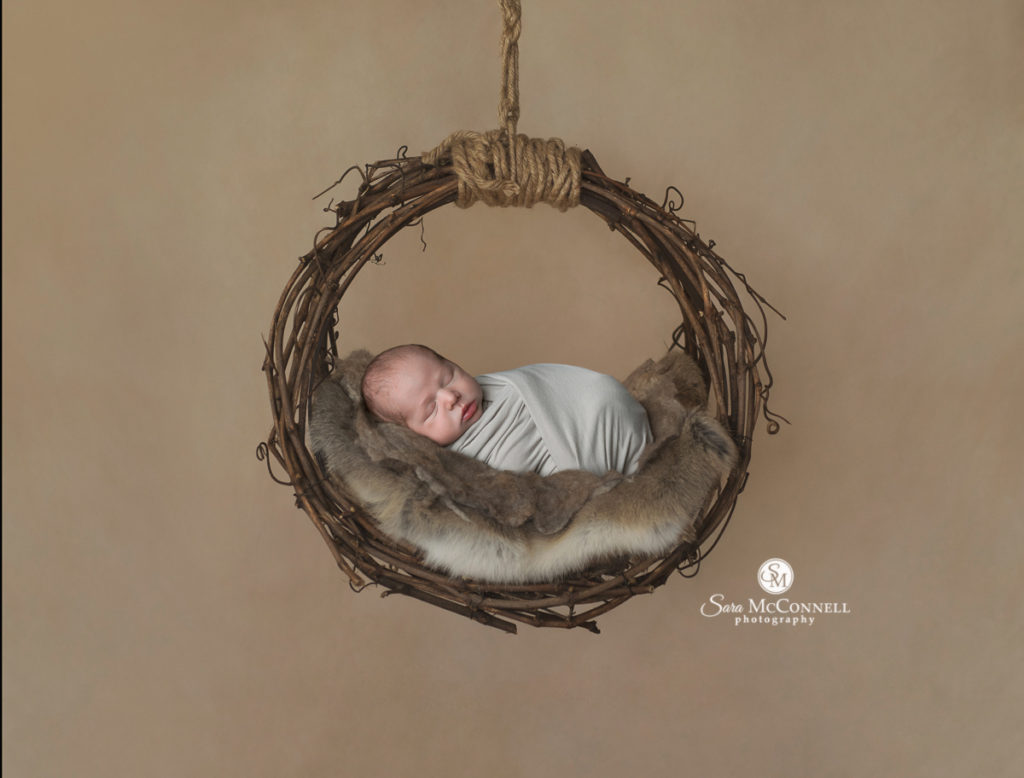 sleeping baby in a grapevine wreath