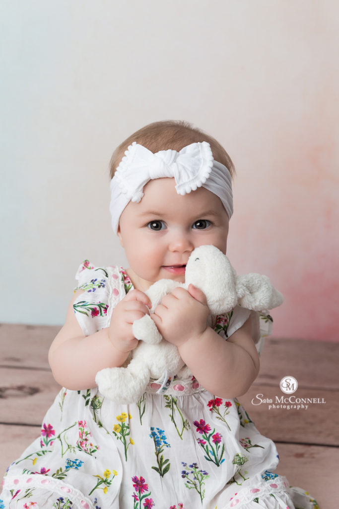 8 month old baby holding a stuffed bunny