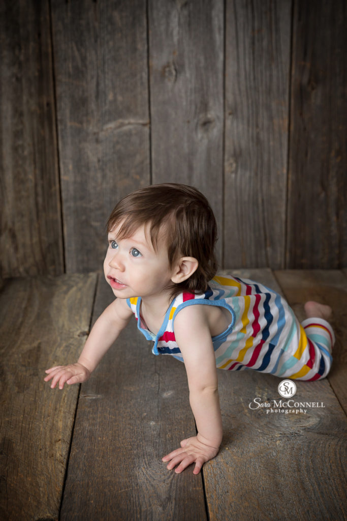 one year old on wooden floor