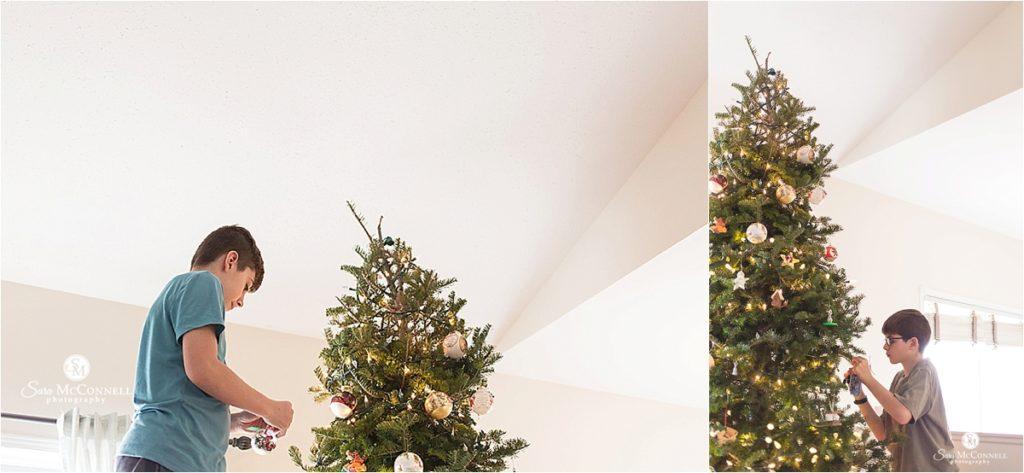 boys decorating a christmas tree