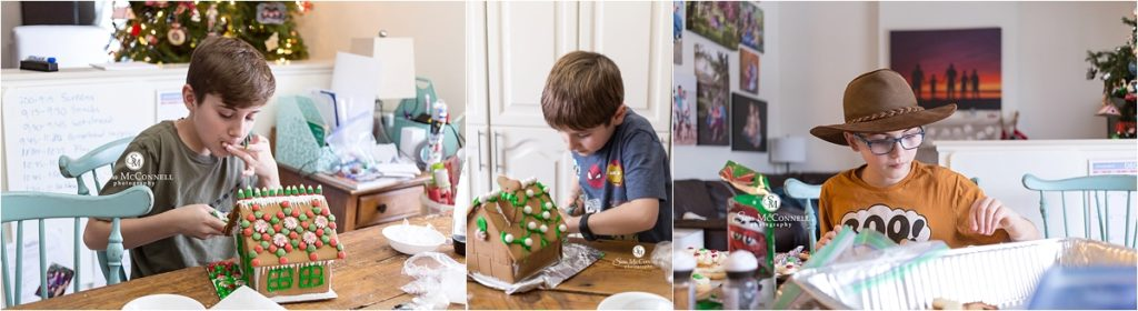 brothers decorating a gingerbread house
