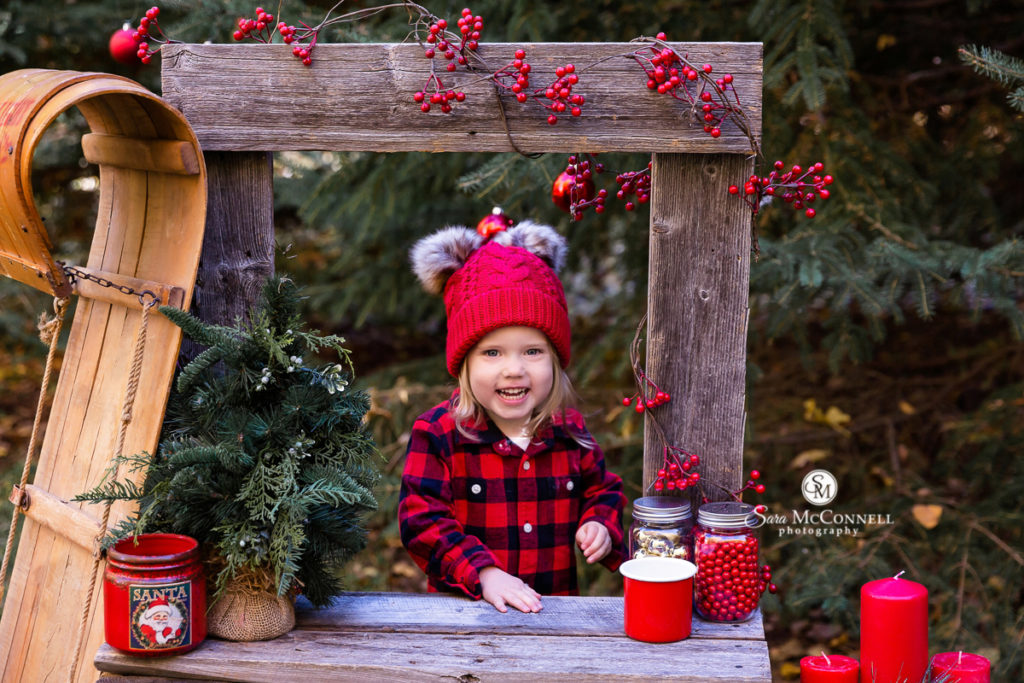 holiday photo with a young girl in buffalo plaid shirt
