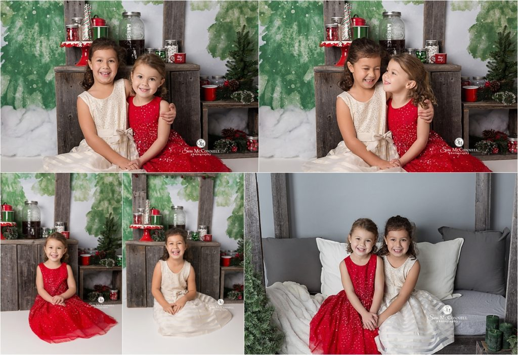 young girls sitting in front of holiday set
