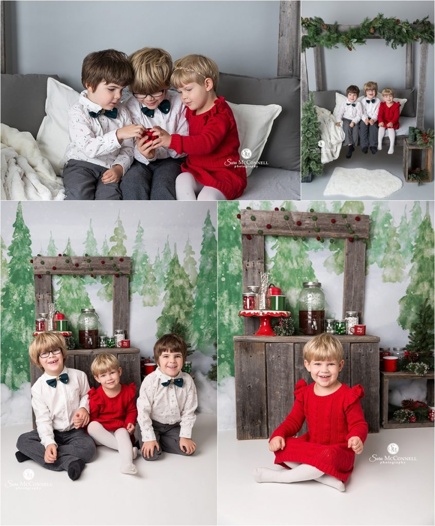 children in front of pretend trees and holiday decor