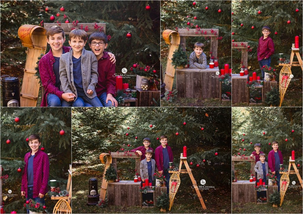 outdoor holiday backdrop with greenery and festive bows