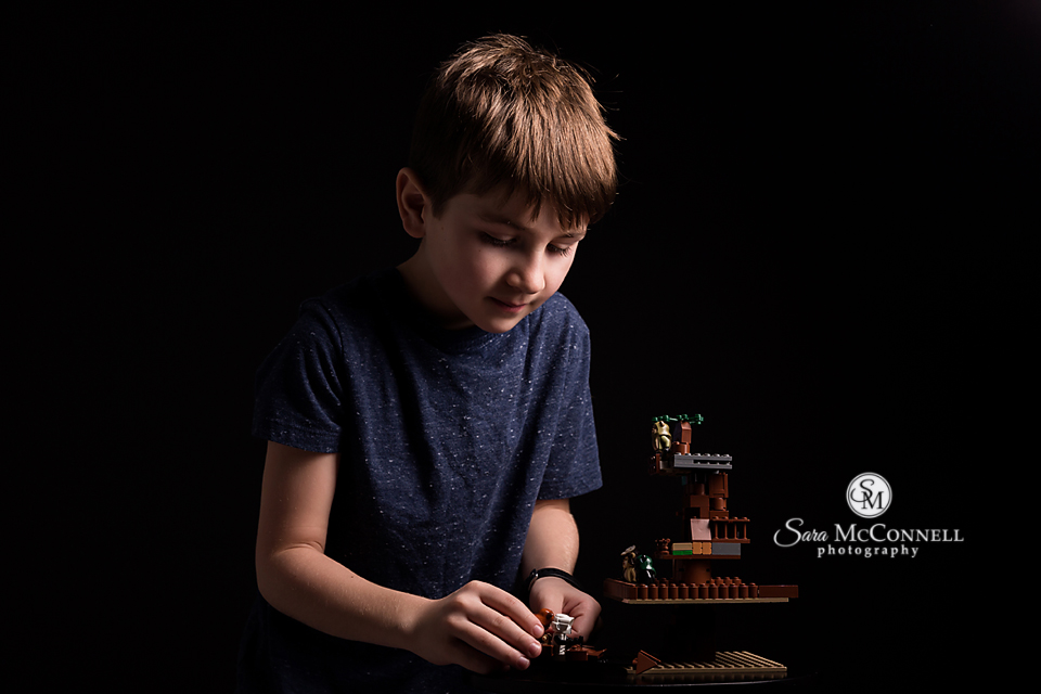 young boy building lego