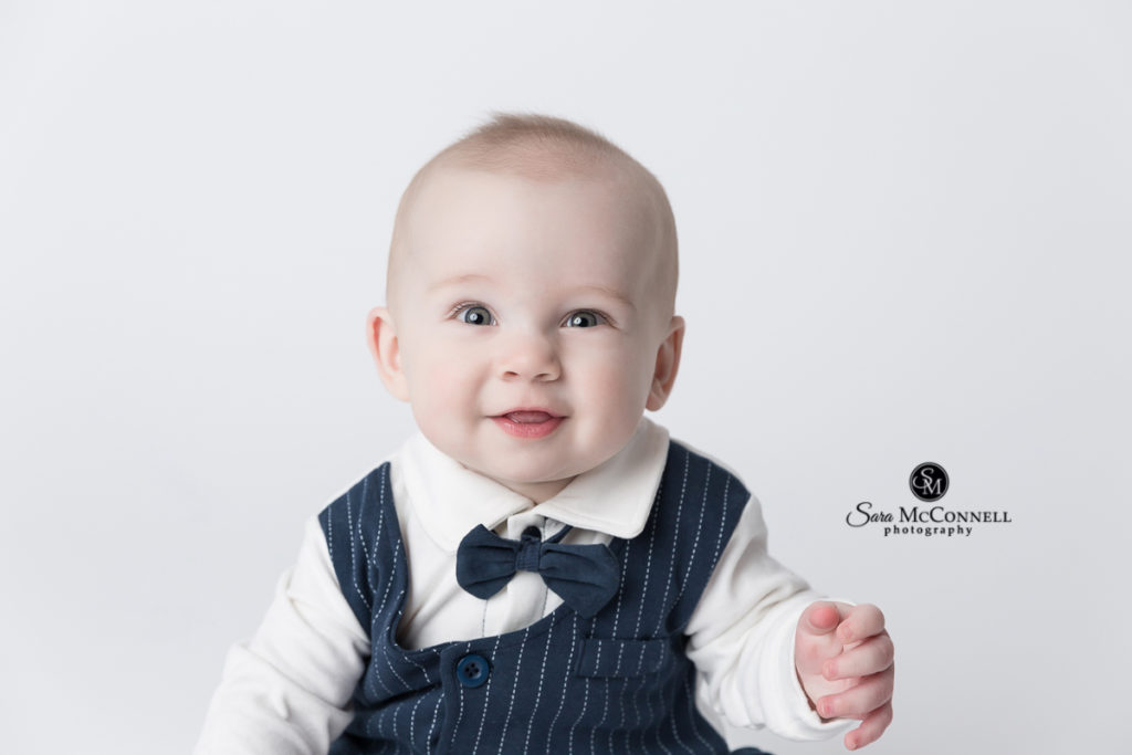 6 month old baby wearing dressy vest and bow tie