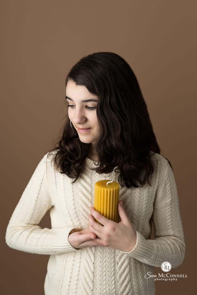 girl holding candle