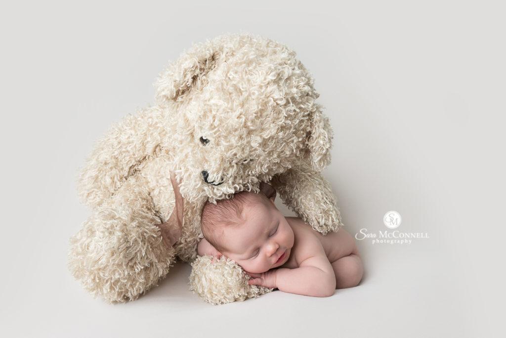 newborn baby and bear